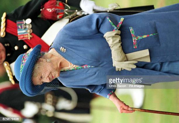 The Queen Mother inspect the 1st Battalion The Black Watch before presenting them with new colours at Birkhall Deeside today POOL Photo by Chris...