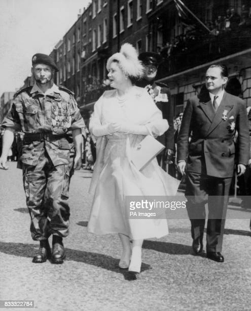 The Queen Mother is escorted by the new French premier M Maurice BourgesMaunoury and the bemedalled Colonel ChateauJobert commander of the Regiment...