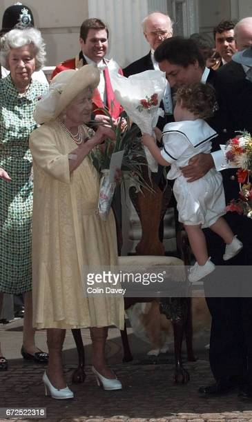 The Queen Mother is handed gifts by members of the public outside St James' Palace at an event to mark her 99th birthday London 4th September 1999