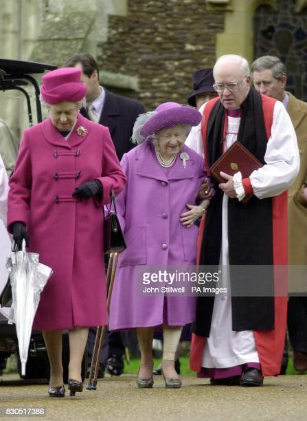 The Queen Mother is helped by Archbishop of Canterbury Dr George Carey as The Queen walks on ahead after she and the Royal Family attended a Sunday...