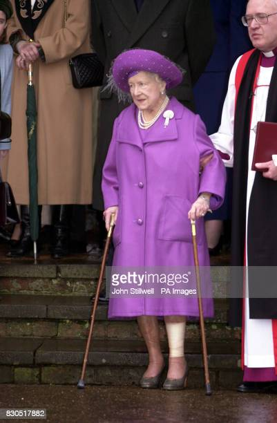 The Queen Mother is helped by Archbishop of Canterbury Dr George Carey after she and the Royal Family attended a Sunday church service St Mary...