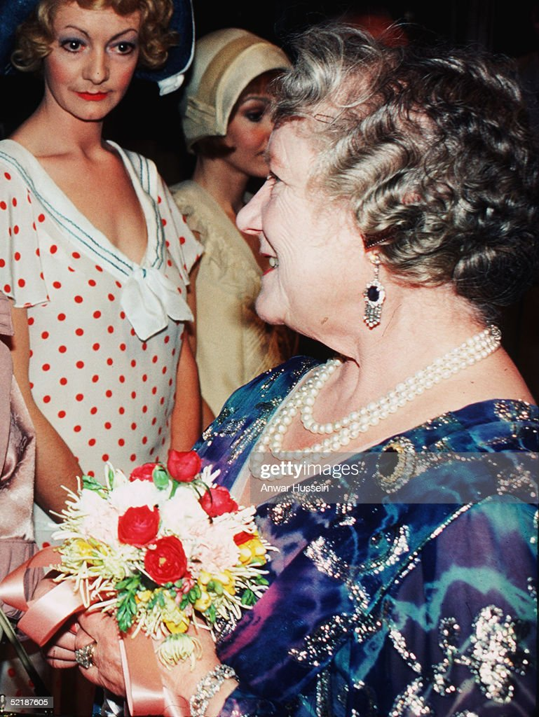 The Queen Mother is seen backstage following the play 'Rookery Nook' by playright Ben Travers, on the night of his 93rd birthday, in 1986 in London. The image shows the Queen Mother wearing the ring Prince Charles has given to Camilla Parker-Bowles to seal their engagement ahead of their wedding on April 8, 2005.