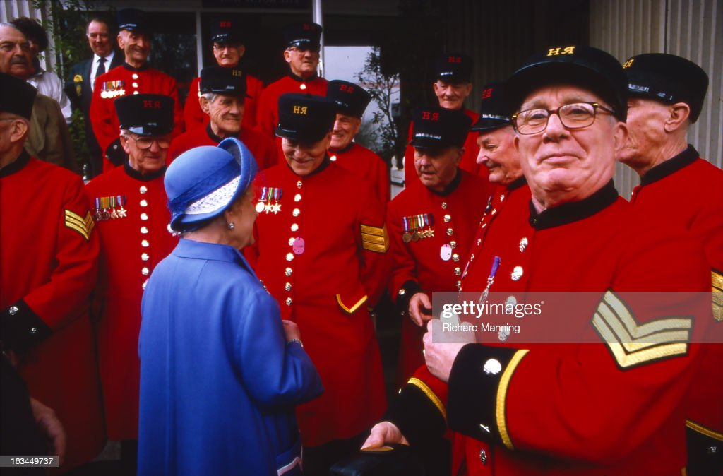 The Queen Mother meeting Chelsea Pensioners whilst attending the Grand Military Gold Cup, held annually at Sandown Park Racecourse in Esher, Surrey. It is a meeting point for the Military, in particularly for Cavalry Officers, with it's origins in the days when mounted Cavalry Officers still rode to war.