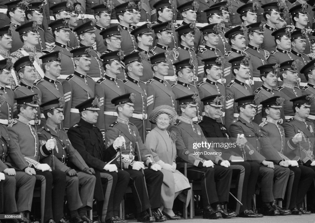 The Queen Mother (1900 - 2002) poses with a group of Irish Guards on St Patrick's Day, after presenting them with the traditional shamrock, 17th March 1981.