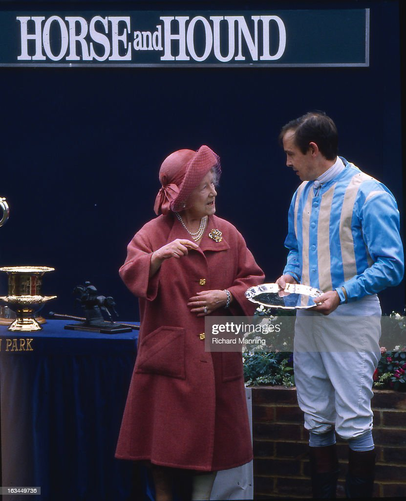 The Queen Mother presents a prize to the winning jockey Major Ollie Ellwood, who rode Norman Conquest to victory in her racing colours, at the annually Military meeting at Sandown Park Racecourse in Esher, Surrey. It is a meeting point for the Military, in particularly for Cavalry Officers, with its origins in the days when mounted Cavalry Officers still rode to war.