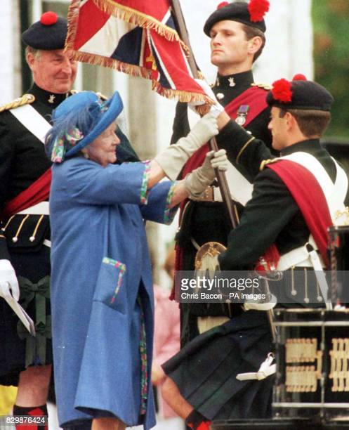 The Queen Mother presents new colours to the 1st Battalion The Black Watch at Birkhall Deeside today POOL Photo by Chris Bacon/PA