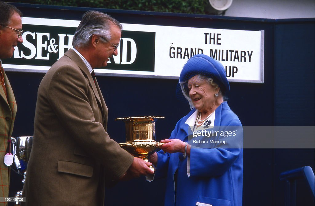 The Queen Mother presents the Grand Military Gold Cup. Held annually at Sandown Park Racecourse in Esher, Surrey, it is a meeting point for the Military, in particularly for Cavalry Officers, with its origins in the days when mounted Cavalry Officers still rode to war.