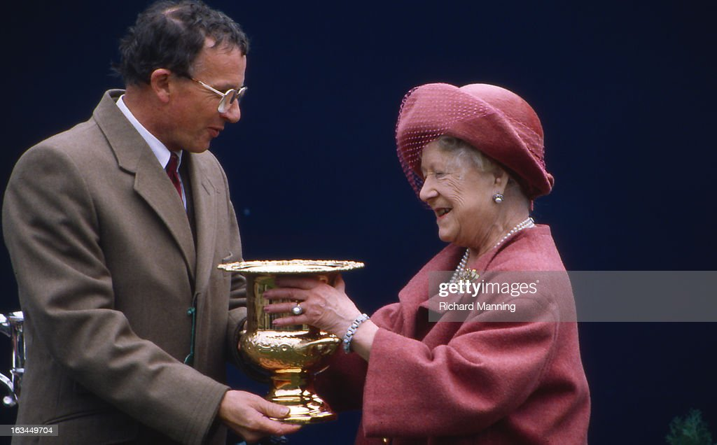 The Queen Mother receives the Grand Military Gold Cup, at the annually held Military meeting at Sandown Park Racecourse in Esher, Surrey. It is a meeting point for the Military, in particularly for Cavalry Officers, with its origins in the days when mounted Cavalry Officers still rode to war.