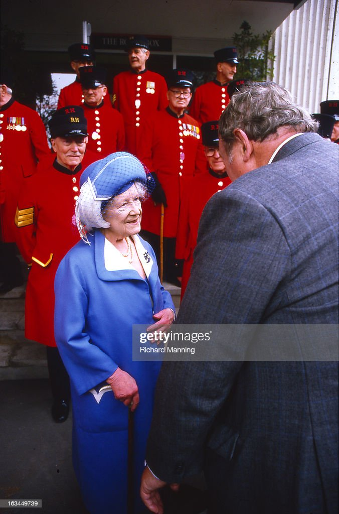 The Queen Mother seen with Chelsea Pensioners whilst attending the Grand Military Gold Cup. Held annually at Sandown Park Racecourse in Esher, Surrey it is a meeting point for the Military, in particularly for Cavalry Officers, with its origins in the days when mounted Cavalry Officers still rode to war.