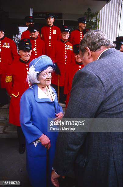 The Queen Mother seen with Chelsea Pensioners whilst attending the Grand Military Gold Cup Held annually at Sandown Park Racecourse in Esher Surrey...