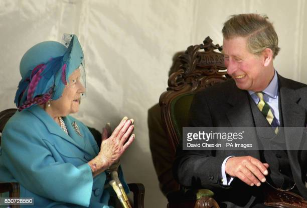 The Queen Mother shares a joke with her grandson Prince Charles known as the Duke of Rothesay in Scotland during the unveiling of an Aberdeen Angus...