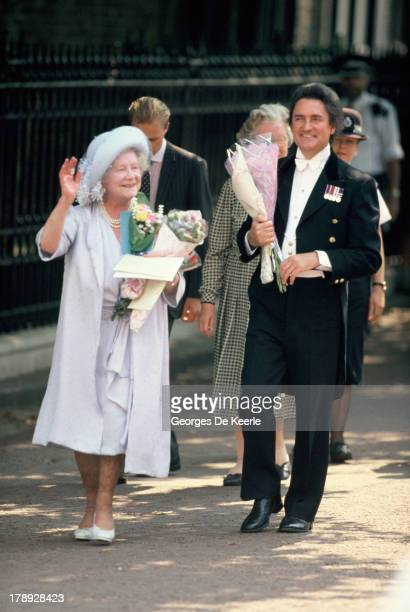 The Queen Mother waves to wellwishers during her 90 Birthday outside Clarence House on August 4 1990 in London England