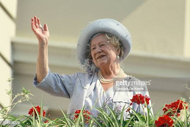 The Queen Mother waves to wellwishers during the celebration of her 90th birthday on August 4 1990 in London England