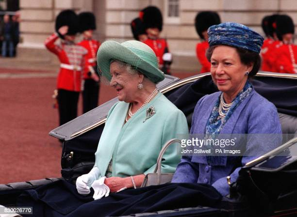 The Queen Mother wearing a pale mint green outfit and matching hat is accompanied by Princess Margaret in an open carriage as they precede the...