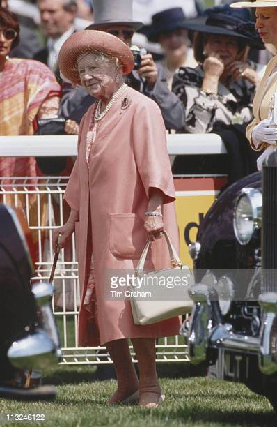 The Queen Mother wearing a peach coloured outfit and hat at the Derby meeting at Epsom racecourse in Epsom Surrey England Great Britain 2 June 1993