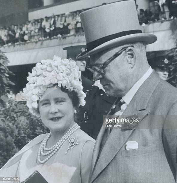 The Queen Mother wears a chic hat as she walks to the paddock at New Woodbine race track with E P Taylor to see the horses that took part in Queen's...