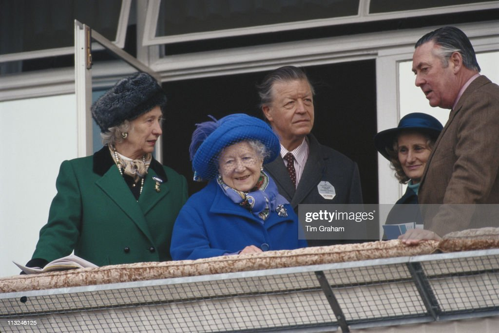 The Queen Mother (1900 - 2002), with Michael Oswald, manager of the Royal Stud, and Samuel Vestey, 3rd Baron Vestey, of the Dewhurst meat chain, at Cheltenham racecourse in Cheltenham, Gloucestershire, England, Great Britain, 13 March 1997.