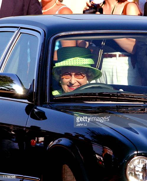 The Queen Of England drives her Jaguar car as she leaves the Cartier International Day held at the Guards Polo Club July 28 2002 in Windsor England