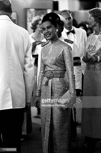 The Queen of Thailand Sirikit wearing an evening dress on the occasion of a concert with works of Johann Sebastian Bach Bangkok 1965