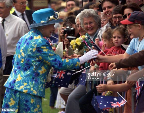 The Queen receives flowers from members of the crowd in Central Park Bourke Australia a small settlement of 3600 people 500 miles north west of...