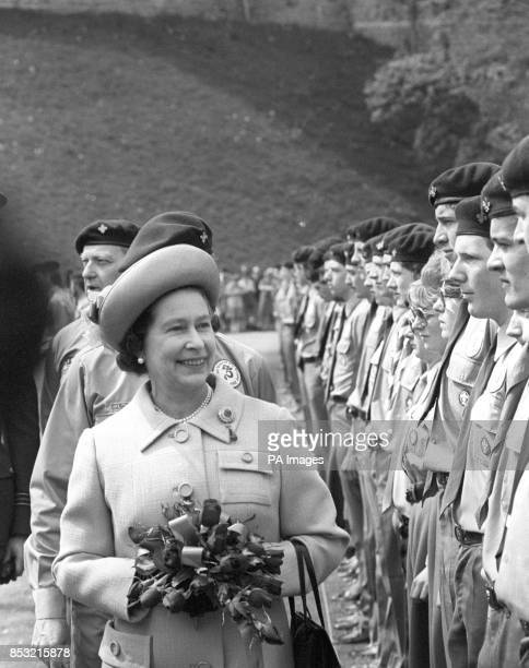 The Queen reviewing a parade of Queen's Scouts at Windsor Castle when the Scout Association held its annual St George's Day parade