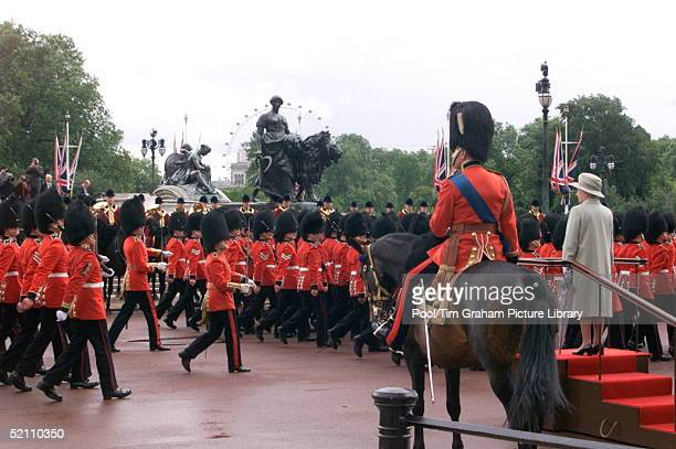 The Queen Reviewing The Guards Outside Buckingham Palace London For Trooping The Colour The Queen's Official Birthday Which Is Celebrated Each Year...