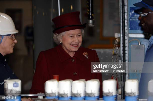 The Queen sees the production line during a visit to the east London Tate Lyle sugar refinery which is celebrating 130 years of production