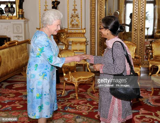The Queen shakes hands with Dr Asma Jahangir of Pakistan during a meeting with the Commonwealth Eminent persons group at Buckingham Palace