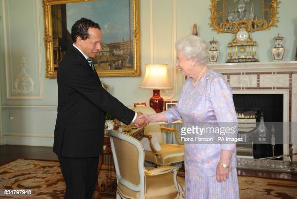 The Queen shakes hands with Lawrence Hill the winner of the writers award for his book 'The Book of Negroes'