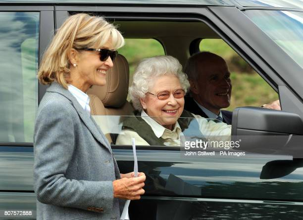 The Queen sits in her Land Rover as she and Lady Brabourne watch the carriage driving competition at the Royal Windsor Horse show in the private...