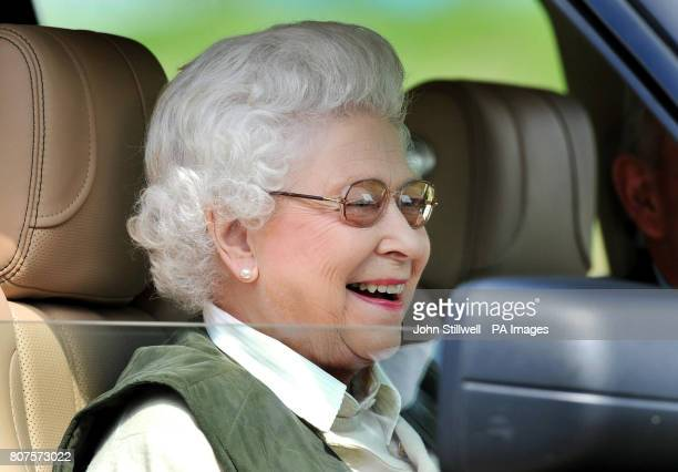 The Queen sits in her Land Rover as she watches the carriage driving competition at the Royal Windsor Horse show in the private grounds of Windsor...