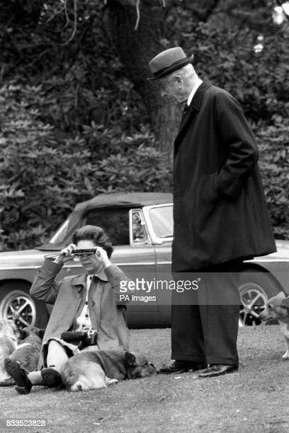 The Queen sitting on a grassy bank with the corgis with Earl Mountbatten at Virginia Water to watch competitors including Prince Philip in the...