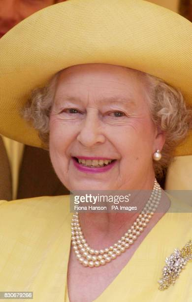 The Queen smiles after laying the foundation stone of the Memorial Gates a monument to Indian African and Caribbean World War volunteers on...
