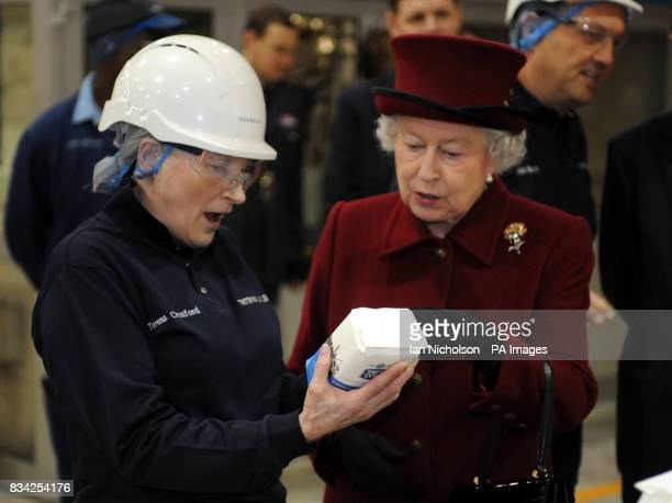 The Queen speaks to Tate Lyle employee Teresa Croxford during a visit to the east London sugar refinery which is celebrating 130 years of production