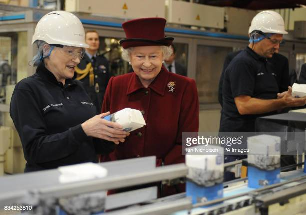 The Queen speaks to Tate Lyle Packing Area Supervisor Teresa Croxford during a visit to the east London sugar refinery which is celebrating 130 years...