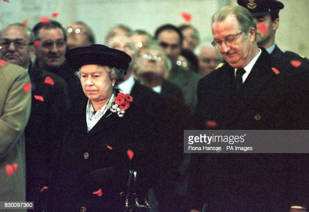 The Queen stands with King Albert Of The Belgians beneath the Menin Gate Ypres Belgium as 55000 poppy petals were dropped to commemorate the soldiers...