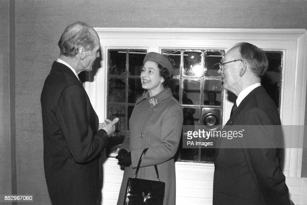 The Queen talking to Group captain Leonard Cheshire VC at the Arnold House Cheshire Home in Enfield when she opened a new wing at the home for...