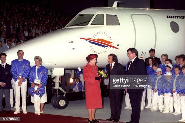 The Queen talking to Jackie Stewart who compered the rollout ceremony of the British Aerospace Jetstream 41 aircraft at Prestwick