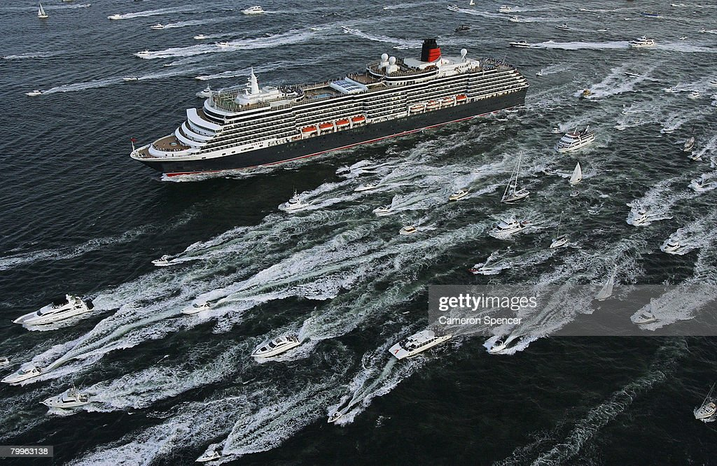 The Queen Victoria Ship heads through Sydney Harbour after a rendezvous with the fellow Cunard luxury liner, the Queen Elizabeth II (QE2) at Garden Island in Sydney Harbour on their first and final voyages to Sydney respectively, on February 24, 2008 in Sydney, Australia. The QE2 is visiting Australian waters for the last time on her 30th anniversary of first doing so, before being retired as a floating hotel in Dubai. The Queen Victoria made her first visit to Sydney overnight and now departs for Brisbane and then Port Douglas on her maiden Australian voyage.