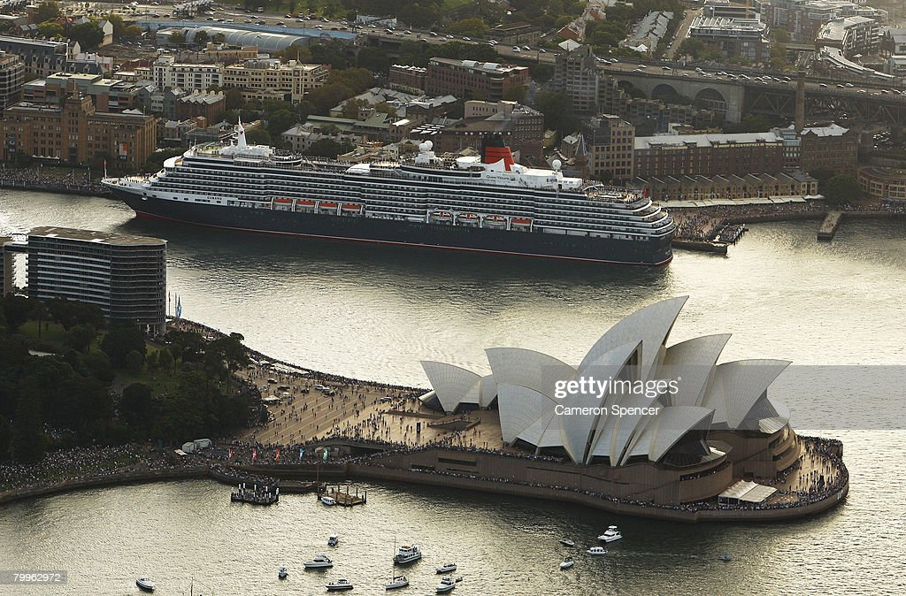 The Queen Victoria Ship is seen docked at the Overseas Passenger Terminal next to the Sydney Opera House prior to its' rendezvous with the fellow Cunard luxury liner, the Queen Elizabeth II (QE2) ship at Garden Island in Sydney Harbour on their final and first voyages to Sydney respectively, on February 24, 2008 in Sydney, Australia. The QE2 is visiting Australian waters for the last time on her 30th anniversary of first doing so, before being retired as a floating hotel in Dubai. The Queen Victoria made her first visit to Sydney overnight and now departs for Brisbane and then Port Douglas on her maiden Australian voyage.
