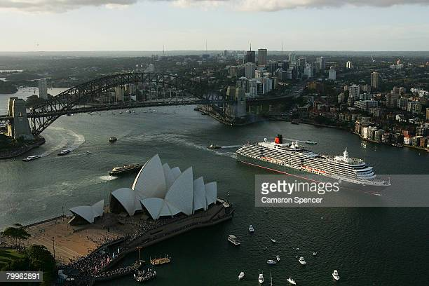 The Queen Victoria Ship passes the Sydney Opera House as it approaches the fellow Cunard luxury liner the Queen Elizabeth II ship at Garden Island in...