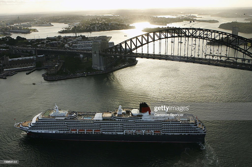 The Queen Victoria Ship reverses in front of the SYdney Harbour Bridge as it approaches the fellow Cunard luxury liner, the Queen Elizabeth II (QE2) ship at Garden Island in Sydney Harbour on their first and final voyages to Sydney respectively, on February 24, 2008 in Sydney, Australia. The QE2 is visiting Australian waters for the last time on her 30th anniversary of first doing so, before being retired as a floating hotel in Dubai. The Queen Victoria made her first visit to Sydney overnight and now departs for Brisbane and then Port Douglas on her maiden Australian voyage.