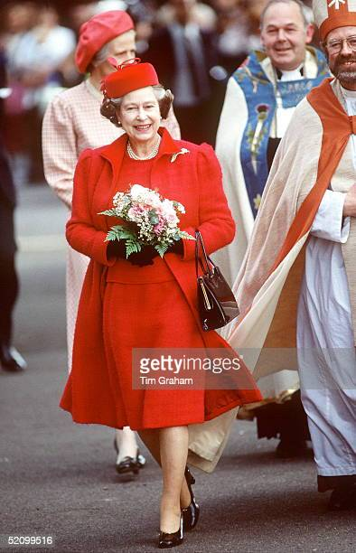 The Queen Visiting St Anne's Church In Kew She Is Wearing A Red Coat