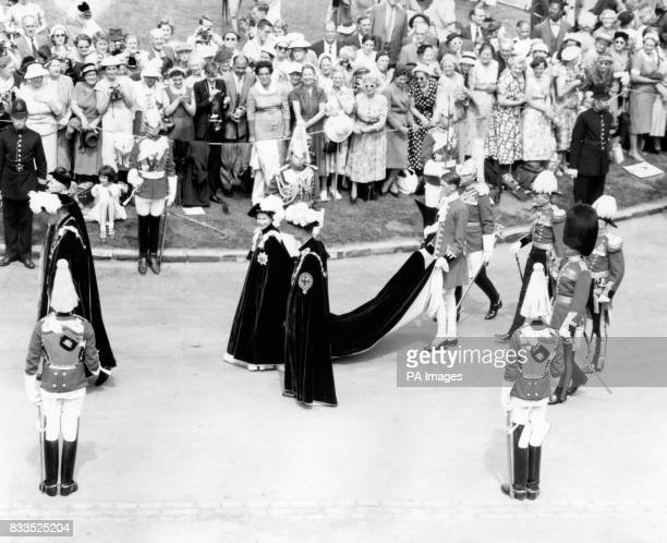 The Queen walks in procession with the Duke of Edinburgh at the Service of the Most Noble Order of the Garter at St George's Chapel Windosr Castle