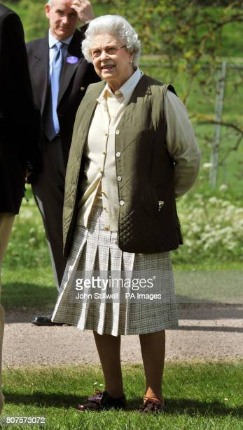 The Queen watches the carriage driving competition at the Royal Windsor Horse show in the private grounds of Windsor Castle