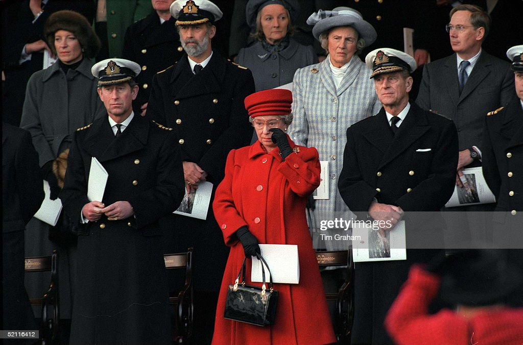 The Queen Wiping A Tear From Her Eye At The De-commissioning Ceremony For Hmy Britannia. With Her Are Prince Philip And Prince Charles And Behind Her Her Lady In Waiting The Duchess Of Grafton