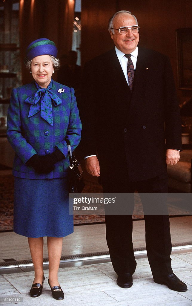 The Queen With Chancellor Helmut Kohl In Bonn, Germany. She Is Wearing An Outfit Designed By Fashion Designer Ian Thomas.