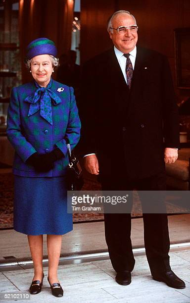 The Queen With Chancellor Helmut Kohl In Bonn Germany She Is Wearing An Outfit Designed By Fashion Designer Ian Thomas