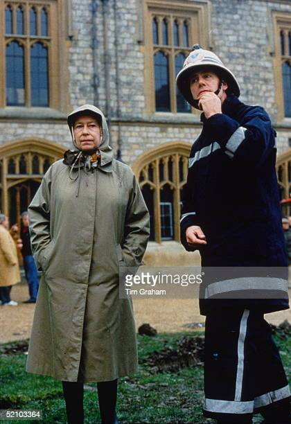 The Queen With Fireman Inspecting The Damage After The Fire At Windsor Castle