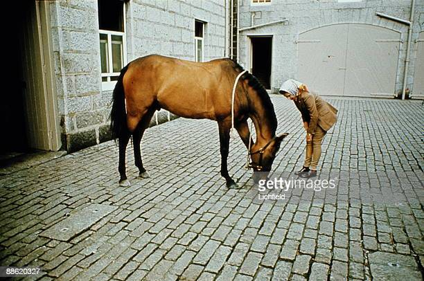 HM The Queen with her horse in the stableyard of Balmoral Castle Scotland during the Royal Family's annual summer holiday in September 1971 Part of a...